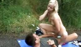 Lovely looking blonde is pounded right from behind outdoors