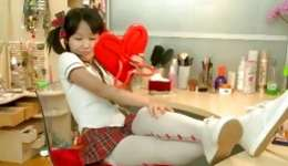 Young asian magnificence is solo playing with a long pink dildo in dirty way