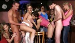 Observe handsome stripper spraying grain on a bride and her maids